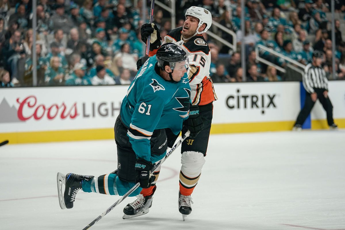 Oct 3, 2018; San Jose, CA, USA; San Jose Sharks defenseman Justin Braun (61) and Anaheim Ducks center Ryan Getzlaf (15) collide during the second period at SAP Center at San Jose.