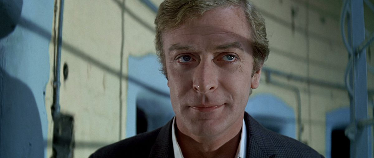 Michael Caine smiling in The Italian Job