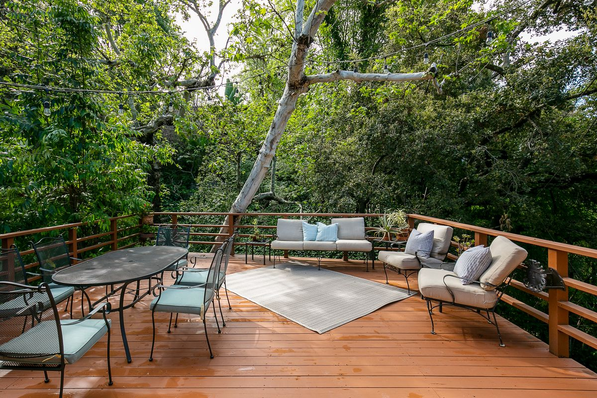 A deck with an outdoor table and chairs