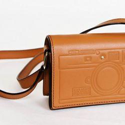 "<a href=""http://www.katespade.com/pocomo-gwen/PXRU2542,default,pd.html?dwvar_PXRU2542_color=102&start=39&cgid=handbags"" rel=""nofollow"">Pocomo Gwen</a>, $225"