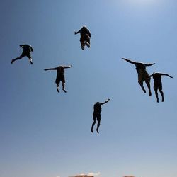Lake Powell rock jumpers leap into the lake Aug. 19, 2007. There has been debate on whether recreation areas and national parks in Utah should be opened and run by the state during the federal government shutdown.