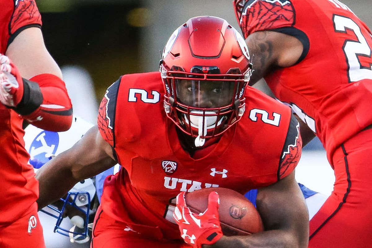 Utah's Zack Moss looks for daylight during a game against BYU at Rice-Eccles Stadium in 2016.