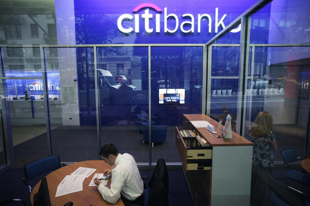 FILE - This Oct. 13, 2011 file photo, shows a Citibank branch in New York. Citigroup reported Monday, April 16, 2012, a profit of $2.9 billion for the first three months of the year. The bank says it collected record revenue from processing international