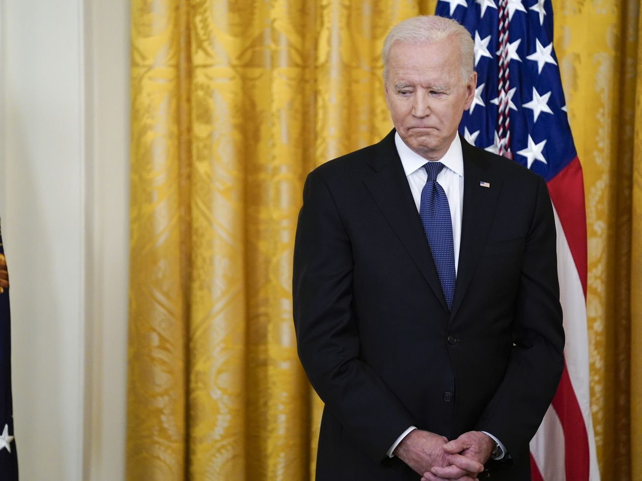 President Joe Biden looks towards the table with the COVID-19 Hate Crimes Act on it before the signing in the East Room of the White House, Thursday, May 20, 2021, in Washington.