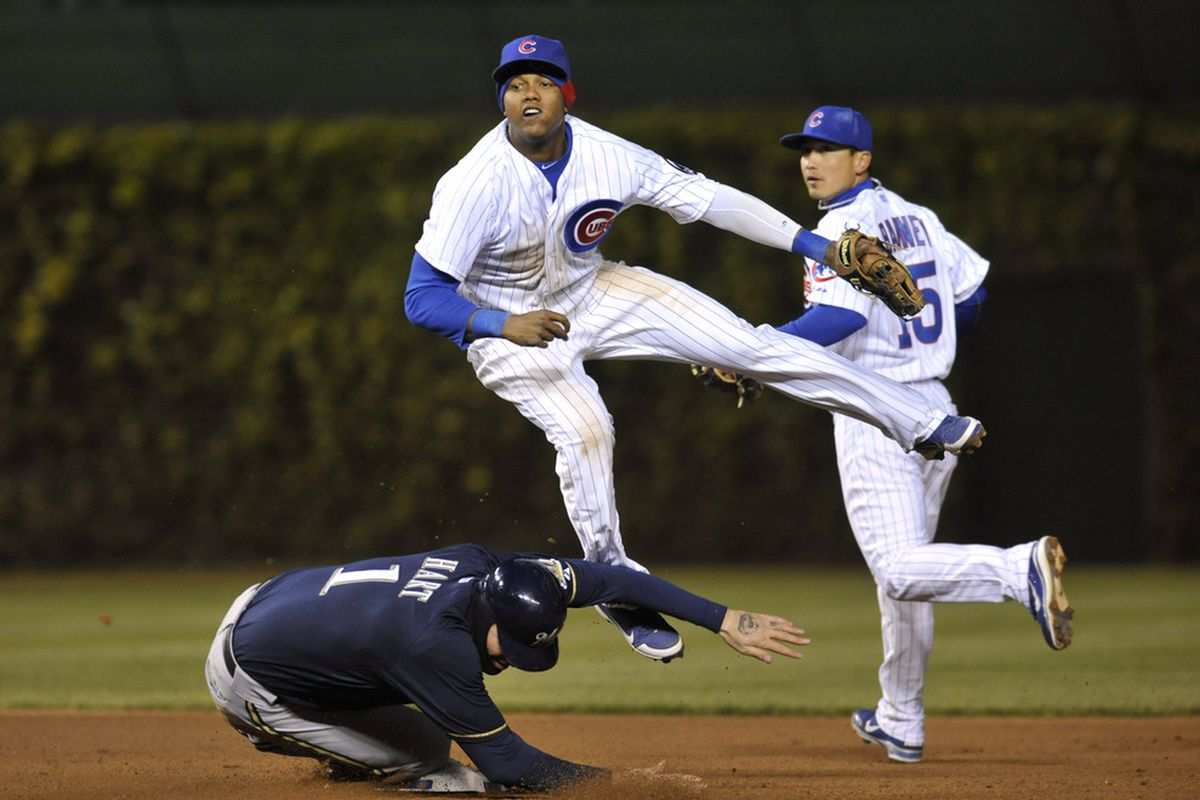 Starlin Castro of the Chicago Cubs forces out Corey Hart of the Milwaukee Brewers at second base in the seventh inning at Wrigley Field in Chicago, Illinois.  (Photo by David Banks/Getty Images)