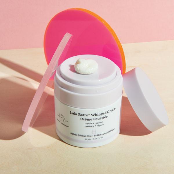 white and purple moisturizer pump