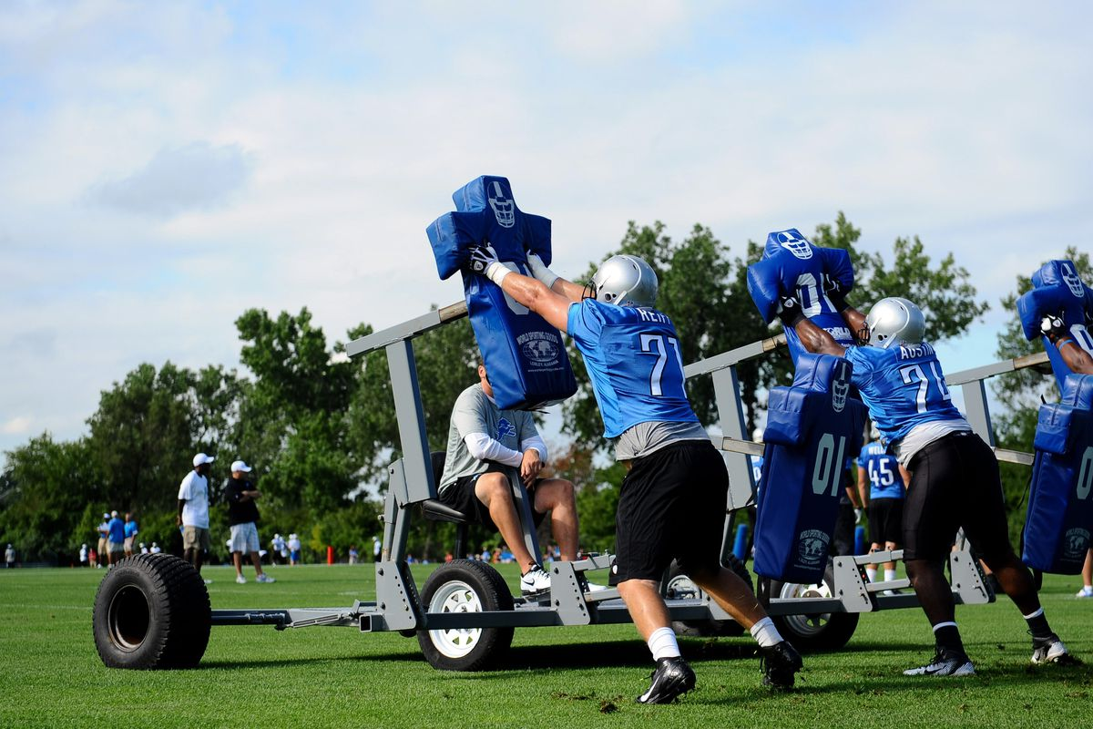 Detroit Lions offensive linemen Riley Reiff (71) and  Rodney Austin (74) complete drills during training camp at the Detroit Lions training facility. Mandatory Credit: Tim Fuller-US PRESSWIRE