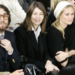 Front row guests singer Sean Lennon, left, director Sofia Coppola, 2nd right, and actress Diane Kruger attend the presentation of Chanel's spring-summer 2007 Haute Couture fashion collection designed by German fashion designer Karl Lagerfeld, Tuesday, Jan. 23, 2007 at the Grand Palais in Paris. (AP Photo/Francois Mori)