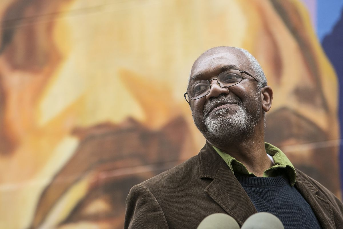 Artist Kerry James Marshall speaks in December at the unveiling and ribbon-cutting ceremony for his 132-foot by 100-foot mural, honoring 20 women who have shaped the city's arts and culture landscape, on an alley outside the Chicago Cultural Center. Marsh