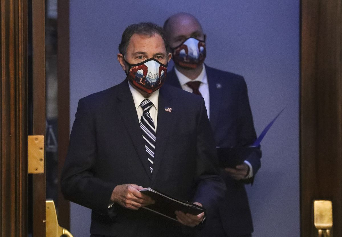 Gov. Gary Herbert and Lt. Gov. Spencer Cox, right, wear Utah-made masks with a depiction of Delicate Arch on them as they attend the daily COVID-19 briefing at the Capitol in Salt Lake City on Tuesday, April 28, 2020.