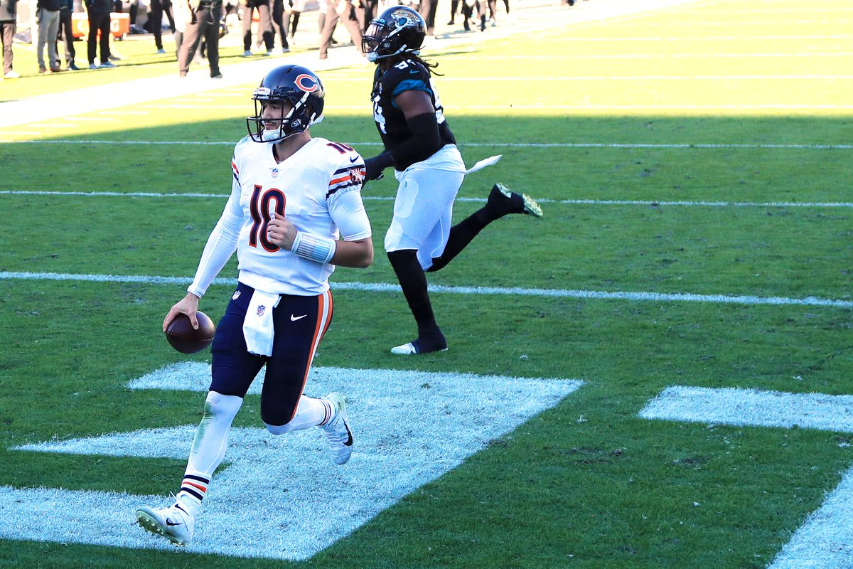 Mitchell Trubisky #10 of the Chicago Bears scores a touchdown during the third quarter against the Jacksonville Jaguars at TIAA Bank Field on December 27, 2020 in Jacksonville, Florida.