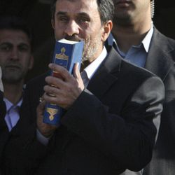 FILE- In this Monday, Sept. 19, 2011 file photo, Iranian President Mahmoud Ahmadinejad, kisses the Quran, Islam's holy book, during his official departure ceremony, as he leaves Tehran's Mehrabad airport, Iran, for New York to attend the UN General Assembly. As Iran's president crafts his talking points for his annual trip to New York, one message is likely to remain near the top: Tehran has not closed the door on nuclear dialogue and is ready to resume negotiations with world powers.