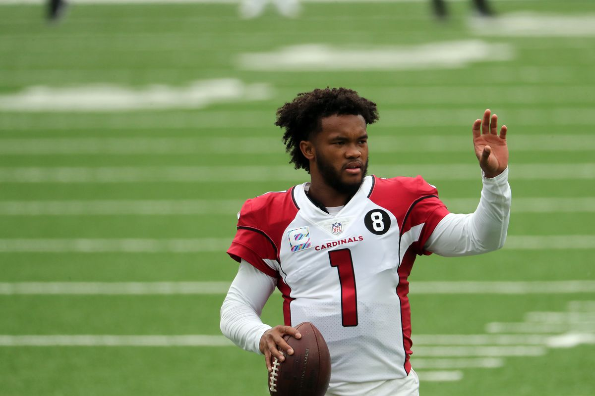 Kyler Murray of the Arizona Cardinals warms up with his helmet off against the New York Jets at MetLife Stadium on October 11, 2020 in East Rutherford, New Jersey. Arizona Cardinals defeated the New York Jets 30-10.