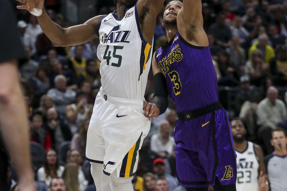 Utah Jazz guard Donovan Mitchell (45) scoops a shot over Los Angeles Lakers guard Josh Hart (3) during the Los Angeles Lakers versus the Utah Jazz at Vivient Smart Home Arena in Salt Lake City on Friday, Jan. 11, 2019.