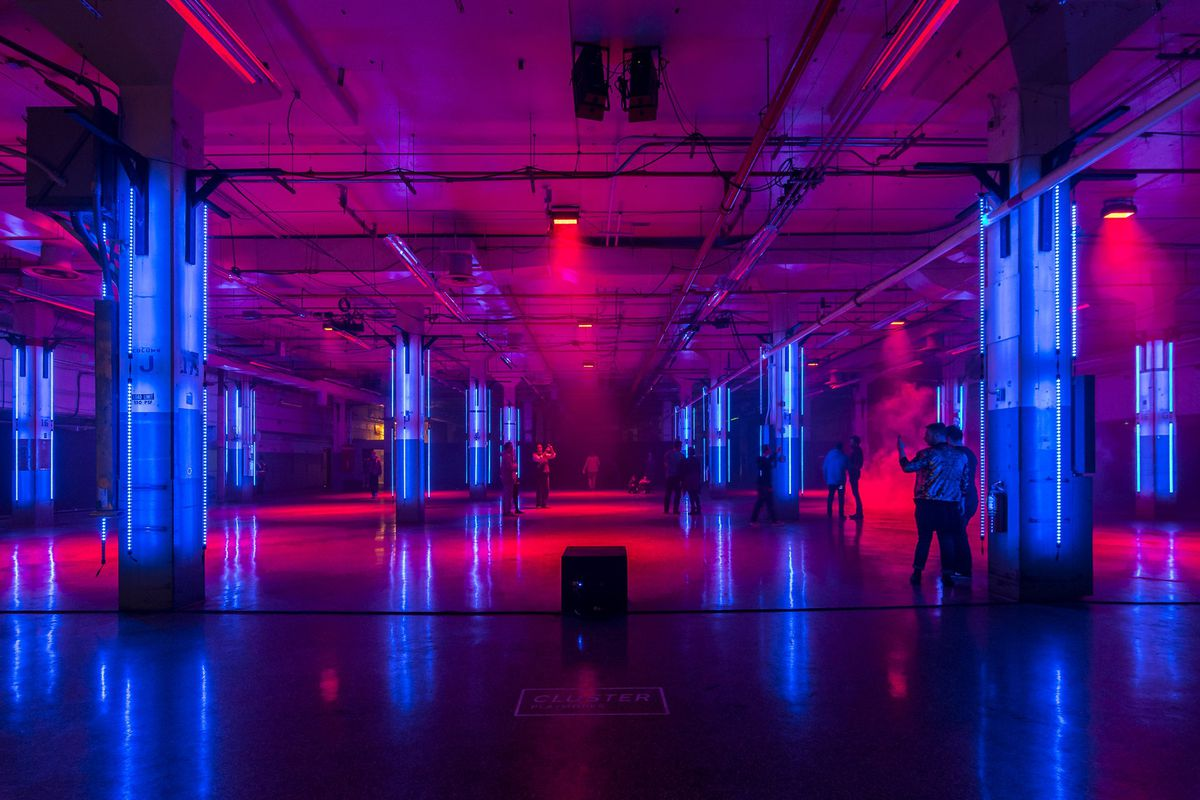 A room lit up with blue and pink