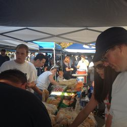 Hungry BYU fans load up on pulled pork at Adrian Jenkins' tailgate before the BYU vs. Boise State game.