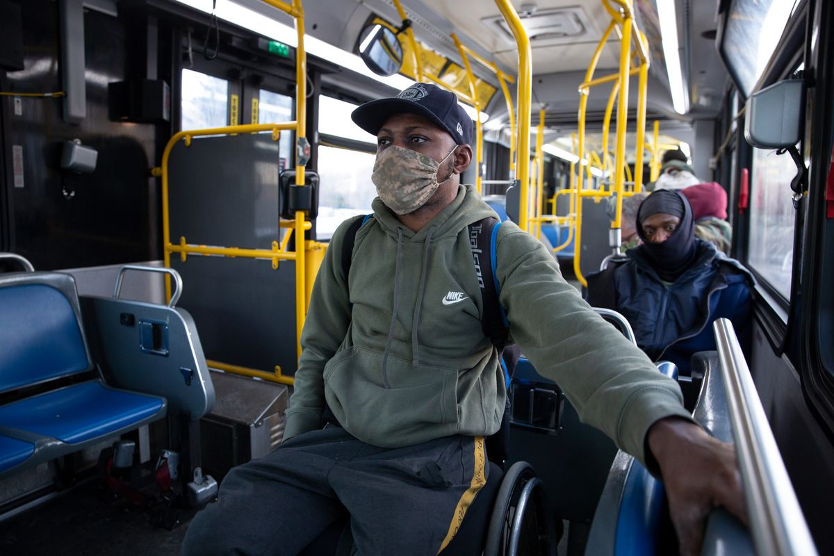 Aare takes an M35 bus at the start of his three-hour commute, Feb. 24, 2021.