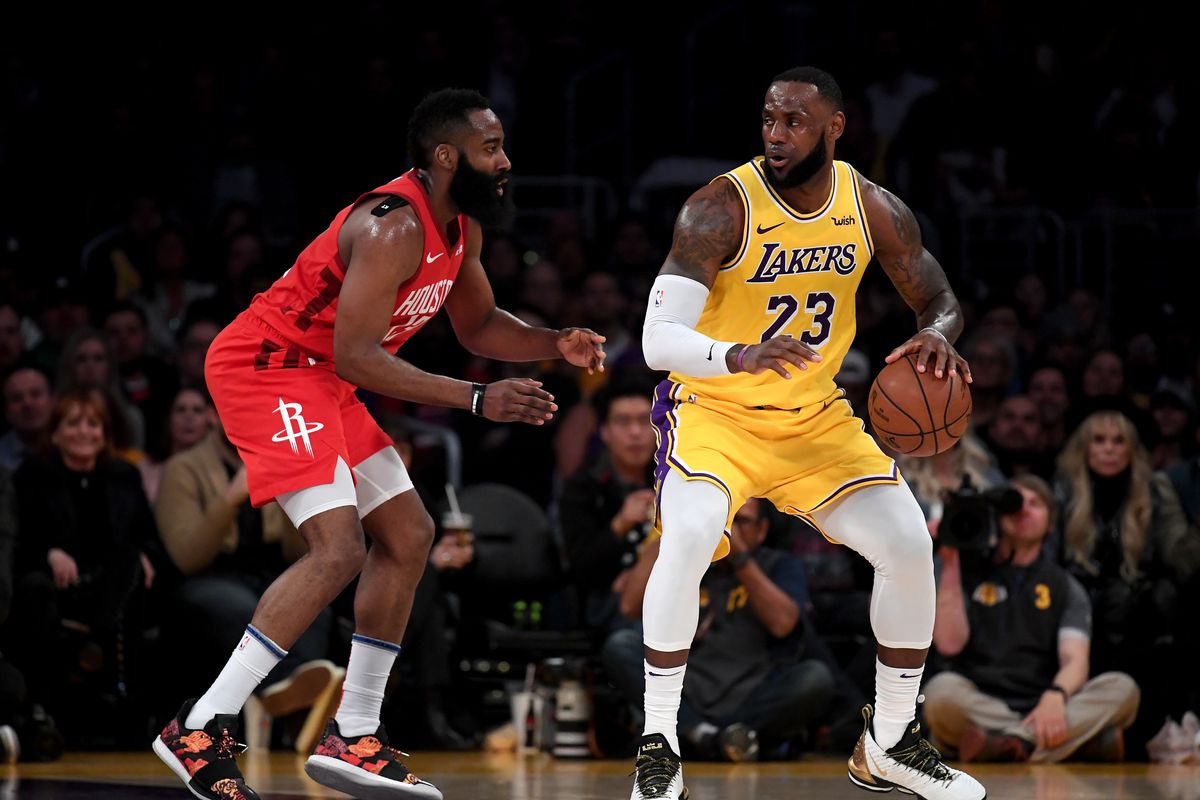 LeBron James of the Los Angeles Lakers backs in on James Harden of the Houston Rockets during a 111-106 Laker win at Staples Center on February 21, 2019 in Los Angeles, California.