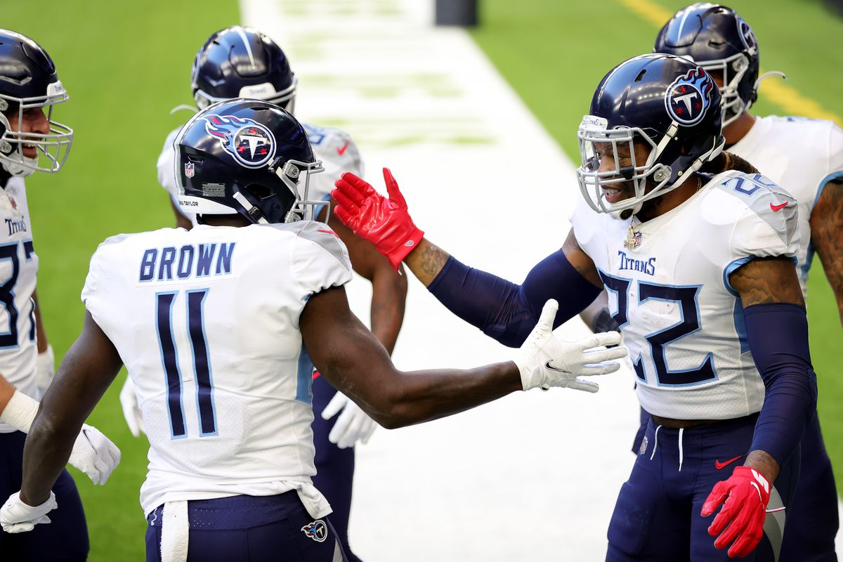 Derrick Henry #22 and A.J. Brown #11 of the Tennessee Titans in action against the Houston Texans during a game at NRG Stadium on January 03, 2021 in Houston, Texas.