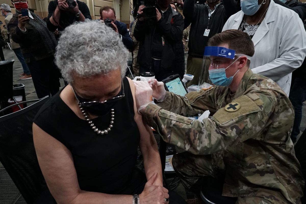 Cook County Board President Toni Preckwinkle receives a COVID-19 vaccine last month at the Tinley Park Convention Center.