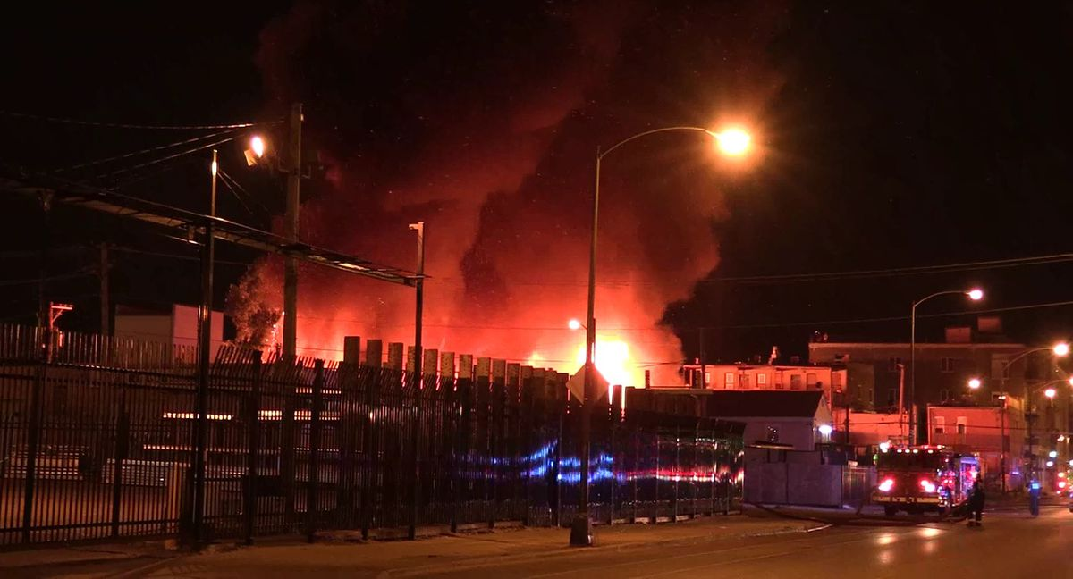 Fire crews battled a three-alarm fire late Monday in a West Town neighborhood warehouse.   Network Video Productions
