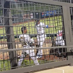 Miguel Romero with other Solar Sox pitchers in the bullpen