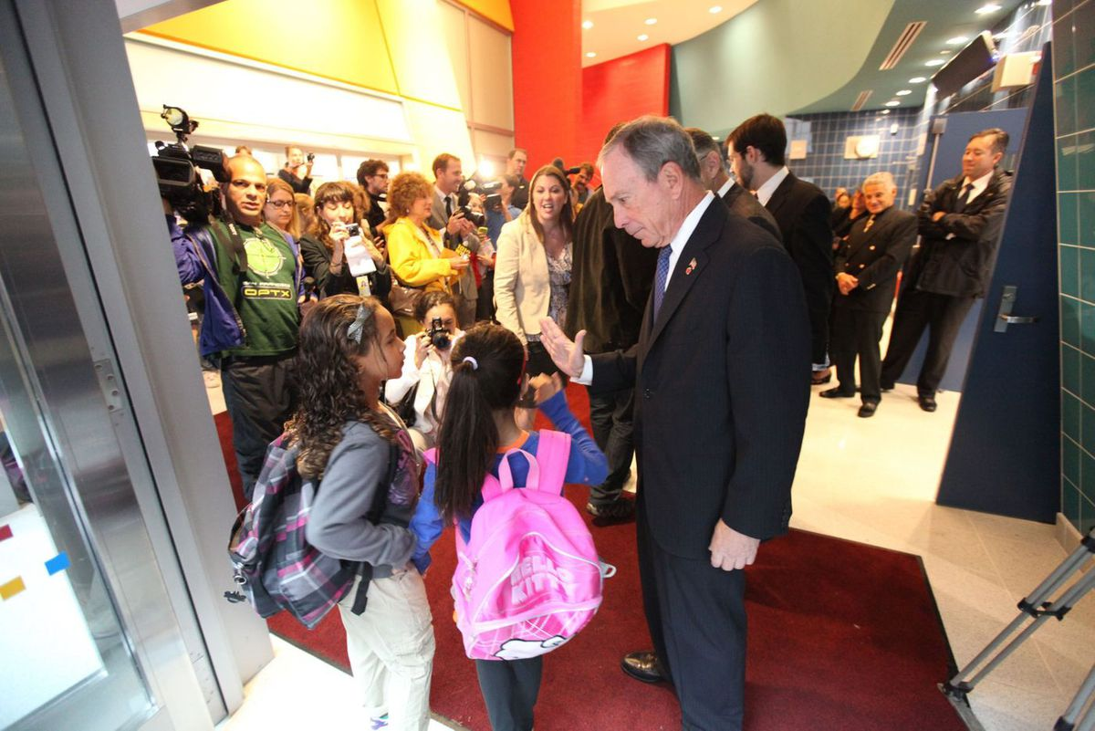 Then-Mayor Michael Bloomberg greets students at the Spruce Street Educational Campus during the first day of school in 2011.