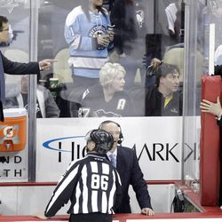 Pittsburgh Penguins assistant coach Tony Granato, left, stands on the boards between benches to talk with Philadelphia Flyers assistant coach Craig Berube, top right, during a on-ice fight during the third period of an NHL hockey game in Pittsburgh Sunday, April 1, 2012. The Flyers won 6-4.