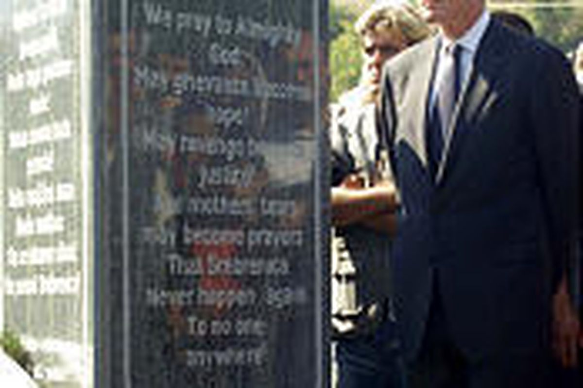 Former President Bill Clinton pays tribute to genocide victims at new memorial in Potocari, Bosnia.