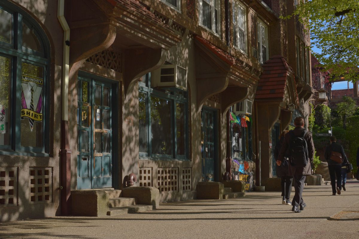 The exterior of shops along a tudor-style street