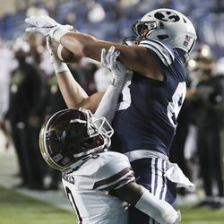 Brigham Young Cougars tight end Isaac Rex (83) grabs a touchdown over Texas State Bobcats cornerback Jarron Morris (0) in Provo on Saturday, Oct. 24, 2020.