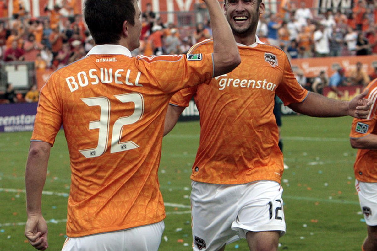 HOUSTON - APRIL 10:  Bobby Boswell #32 of the Houston Dynamo celebrates his first half goal with Will Bruin #12 at Robertson Stadium on April 10, 2011 in Houston, Texas.  (Photo by Bob Levey/Getty Images)