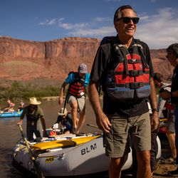 Sen. Mitt Romney, R-Utah, walks up the shore while rafting a section of the Colorado River northeast of Moab on Saturday, Sept. 18, 2021.