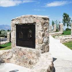 The new stone-and-placard lined Walk of Pioneer Faiths, outside The Garden Place at This Is the Place Heritage Park, commemorates the history and contributions of Utah pioneers of many religions.