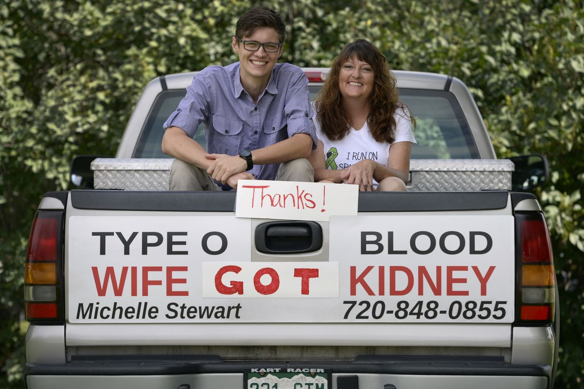 """A kidney donor, Mason Holland, poses with the recipient, Michelle Stewart. Stewart's husband had posted an """"advertisement"""" on the back of his truck."""