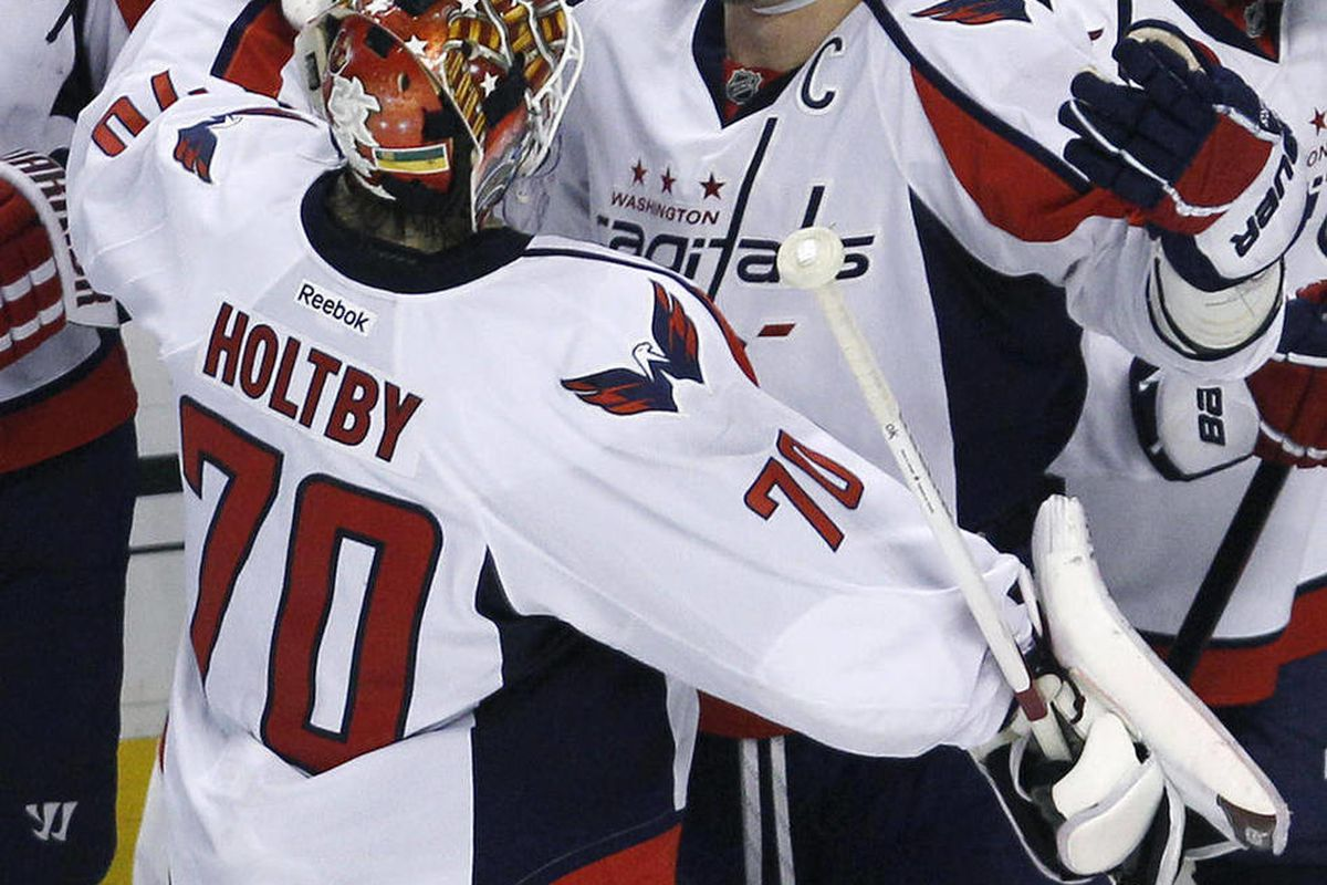 Washington Capitals goalie Braden Holtby (70) celebrates with teammate Alex Ovechkin after the Capitals' 2-1 win over the Boston Bruins in overtime in Game 7 of an NHL hockey Stanley Cup first-round playoff series, in Boston on Wednesday, April 25, 2012.