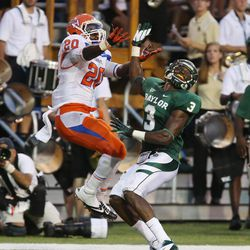 Sam Houston State  Tim Flanders (20), left, pulls down a touchdown pass over Baylor defensive back Demetri Goodson (3), right, in the first half of an NCAA college football game on Saturday, Sept. 15, 2012, in Waco, Texas.