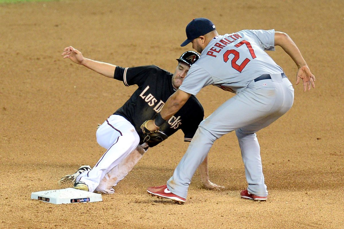 Jhonny Peralta tags out AJ Pollock in last season's September matchup.