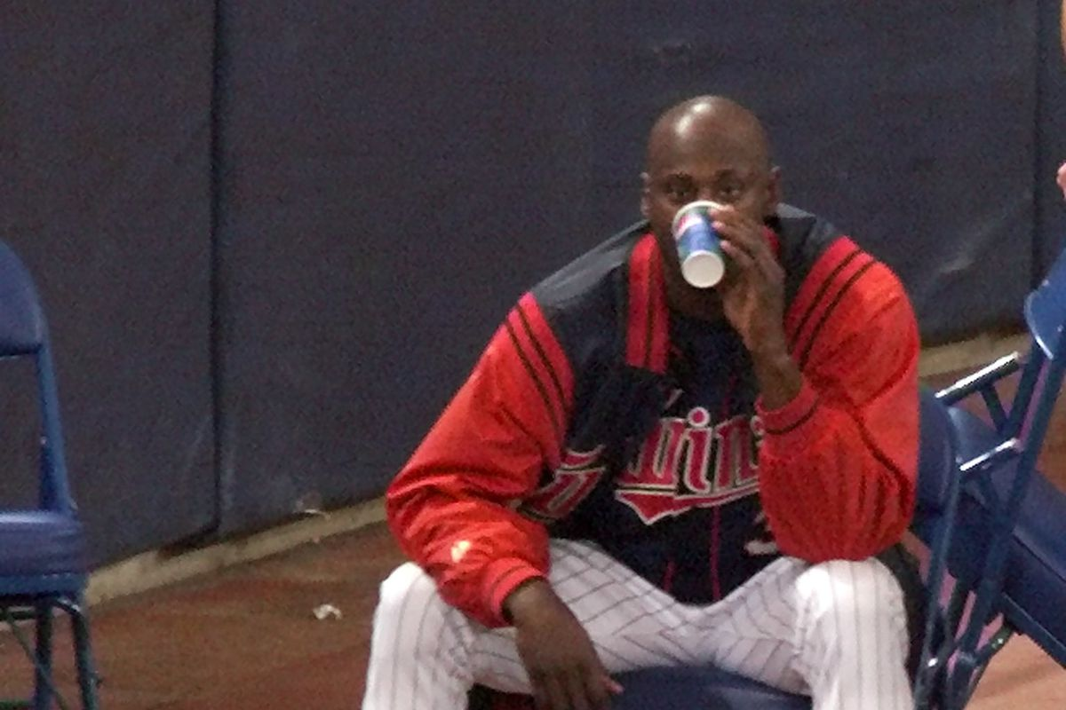 Twins reliever LaTroy Hawkins sits alone in the Twins bullpen awaiting a late-inning call to the mound.