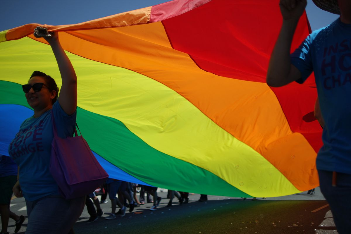 Marchers with a rainbow flag in West Hollywood.