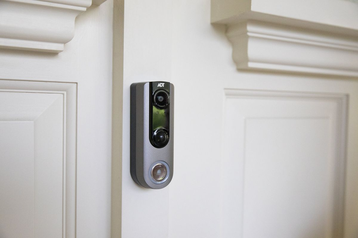 An ADT video doorbell on the exterior of a home.