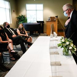 A guest greets family members after paying respects to Judge Michael Kwan at Taylorsville City Hall in Taylorsville on Friday, July 31, 2020.Kwan died July 21. Social distancing is required because of the COVID-19 pandemic.