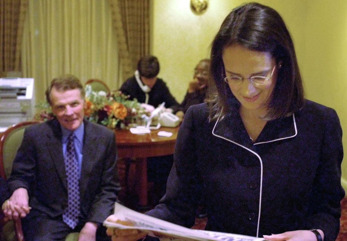 Lisa Madigan reads an article about herself as her father, Illinois House Speaker Michael Madigan, watches her as they await election results on the night of the 2002 Democratic primary.
