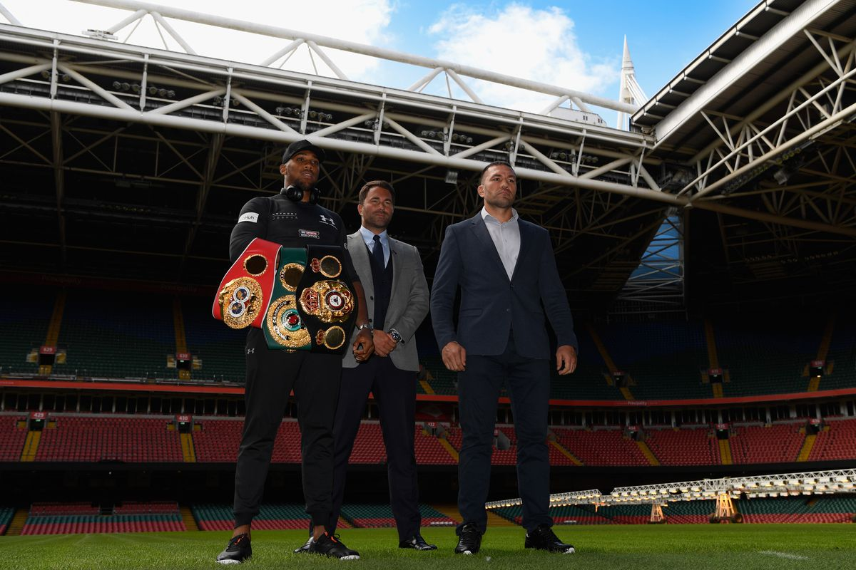 Anthony Joshua (l) and Kubrat Pulev pictured with promoter Eddie Hearn (c) during a media opportunity ahead of their World Heavyweight title clash at Principality Stadium on September 11, 2017 in Cardiff, Wales.