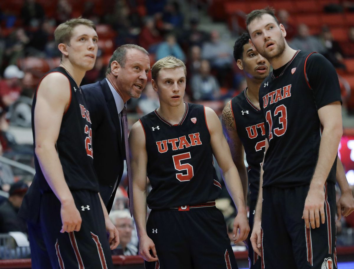 Utah coach Larry Krystkowiak talks to players, including guard Parker Van Dyke (5), during the second half of the team's NCAA college basketball game against Washington State, Saturday, Feb. 17, 2018, in Pullman, Wash. Utah won 77-70.