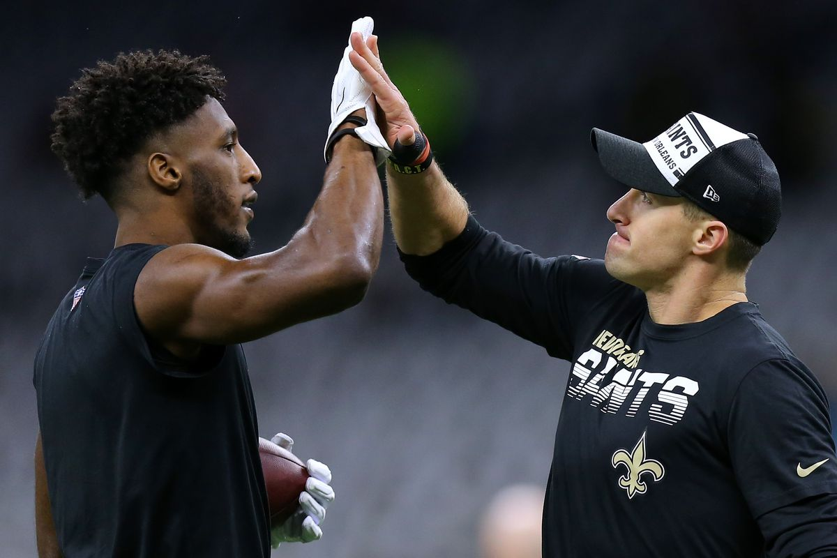 Drew Brees of the New Orleans Saints and Michael Thomas react during a game against the Carolina Panthers at the Mercedes Benz Superdome on November 24, 2019 in New Orleans, Louisiana.