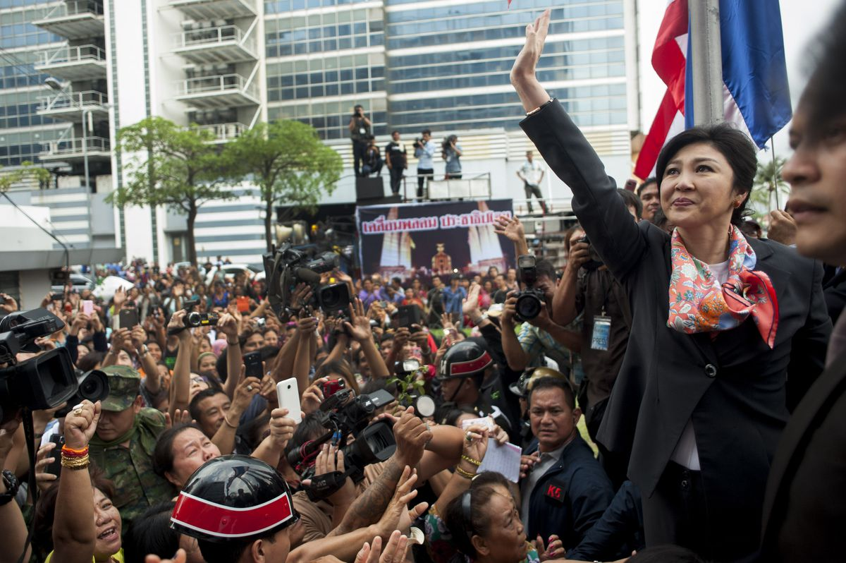 Former Prime Minister Yingluck Shinawatra waves to supporters in May 2014 (Borja Sanchez-Trillo/Getty)