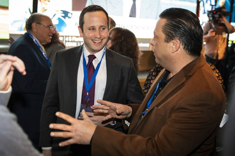 State Rep. Bob Rita (right) chats with Marcus Fruchter, administrator of the Illinois Gaming Board, during the public opening of BetRivers Sportsbook in Des Plaines in March 2020.