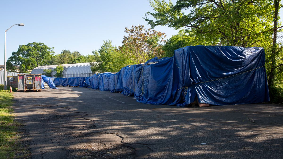 PPE was left exposed to the elements outside the New York State Veterans' Home at St. Albans in Queens, May 13, 2021.