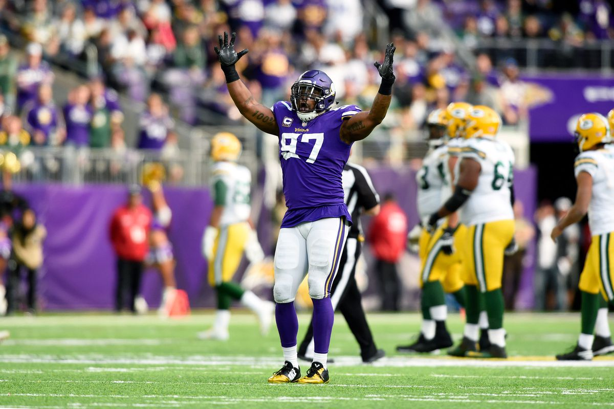 Everson Griffen with his hands in the air